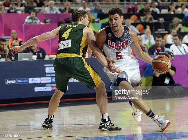 Klay Thompson of USA is in action against Martynas Pocius of Lithuania during 2014 FIBA World Basketball Championship SemiFinal basketball match...