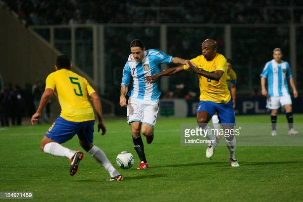 Kléber from Brazil fights for the ball with Juan Manuel Martínez from Argentina during the first match of the Superclasico de la Americas at Mario...