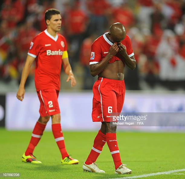 Kleber and Bolivar of Sport Club Internacional look dejected after conceding the second goal during the FIFA Club World Cup 2010 match between TP...