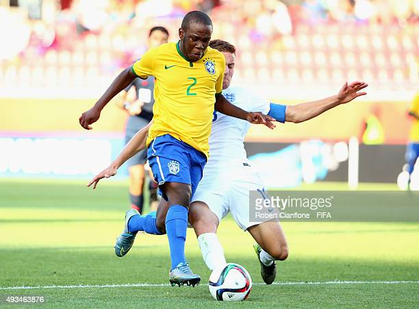 Kleber of Brazil is challenged by Herbie Kane of England during the FIFA U17 World Cup Group B match between England and Brazil at Estadio La Portada...