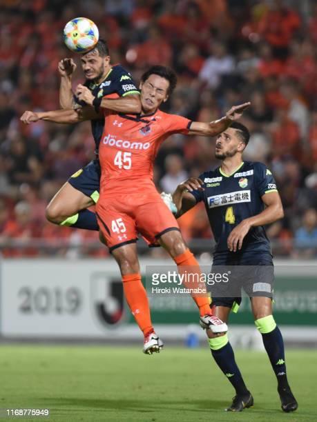 Kleber of JEF United Chiba and Kazuki Kushibiki of Omiya Ardija compete for the ball during the J.League J2 match between Omiya Ardija and JEF United...