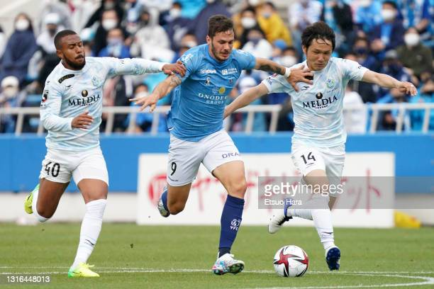 Kleber of Yokohama FC controls the ball under pressure from Oliveira and Akimi Barada of Shonan Bellmare during the J.League YBC Levain Cup Group C...