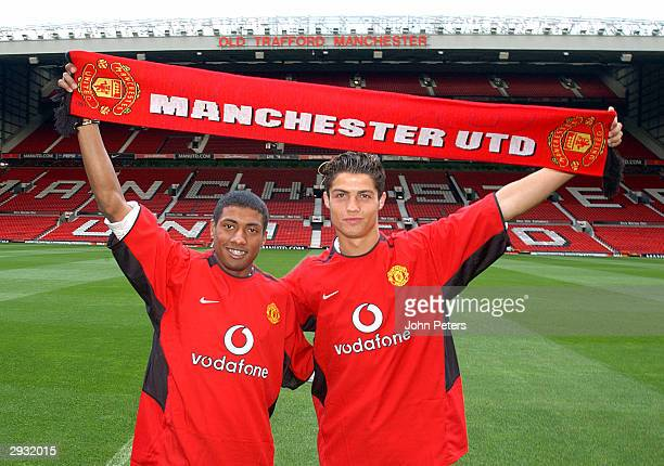 Kleberson and Cristiano Ronaldo pose for photographers on the pitch at Old Trafford on August 13 2003 in Manchester England