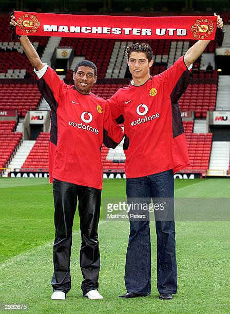 Kleberson and Cristiano Ronaldo pose for photographers on the pitch during the players official signing at Old Trafford on August 13 2003 in...