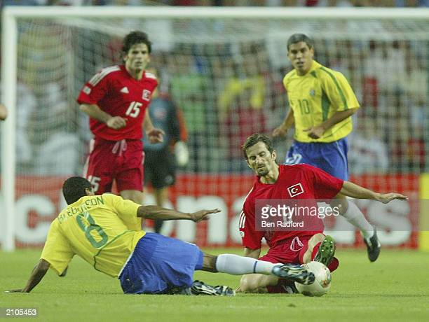 Kleberson of Brazil and Ergun Penbe of Turkey clash during the Confederation Cup Group B match between Brazil and Turkey at the Stade Geoffroy...