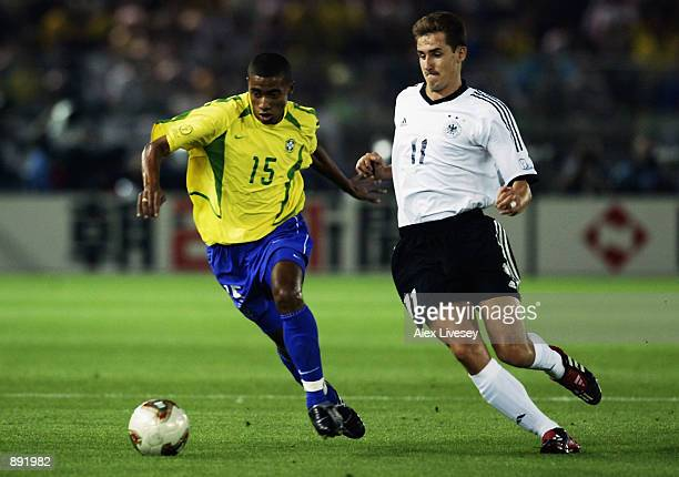 Kleberson of Brazil is watched by Miroslav Klose of Germany during the Germany v Brazil World Cup Final match played at the International Stadium...
