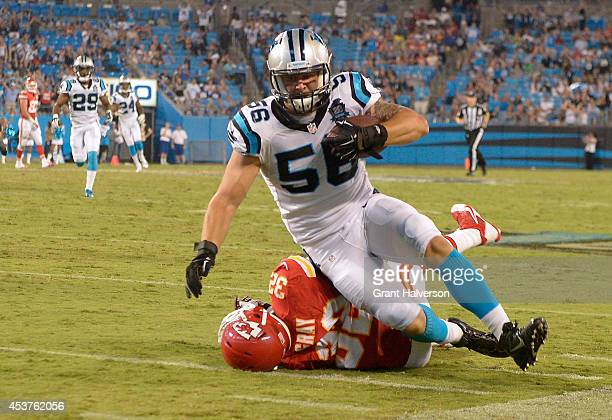 J Klein of the Carolina Panthers is tackled by Cyrus Gray of the Kansas City Chiefs after returning an interception at Bank of America Stadium on...