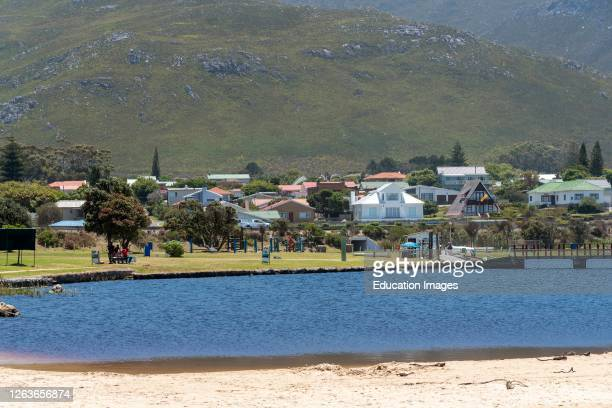 Kleinmond, Western Cape, South Africa, Saltwater lagoon overlook by holiday homes and private properties at Kleinmond a small town.