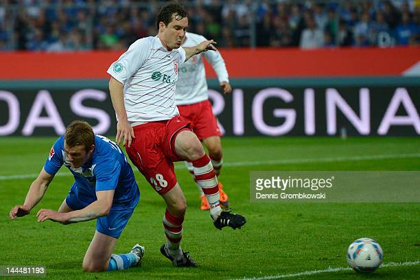 Klemen Lavric of Karlsruhe scores his team's first goal under the pressure of Sebastian Nachreiner during the Second Bundesliga relegation match...