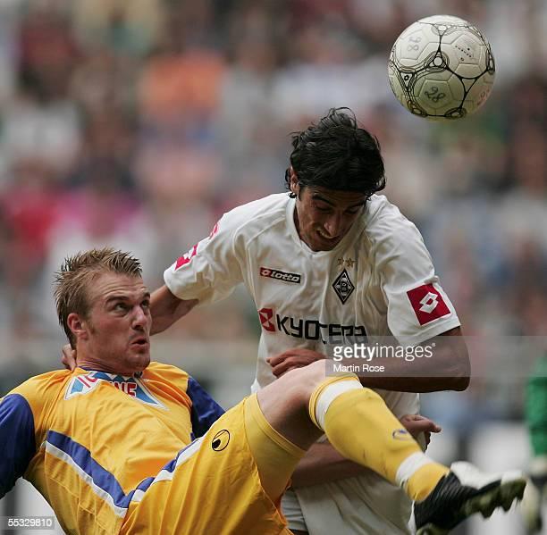 Klemen Lavris of Duisburg is attacked by Ze Antonio of Moenchengladbach during the Bundesliga match between Borussia Monchengladbach and MSV Duisburg...