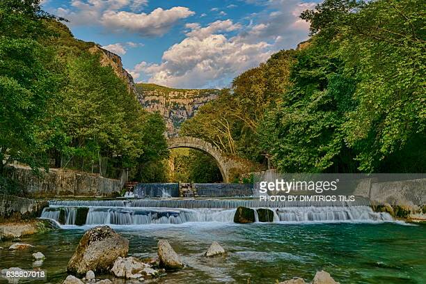 klidhonia's stone bridge & waterfalls - epirus greece stock pictures, royalty-free photos & images