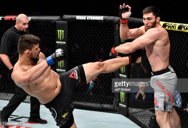 Klidson Abreu of Brazil kicks Shamil Gamzatov of Russia in their light heavyweight bout during the UFC Fight Night event at CSKA Arena on November 09...