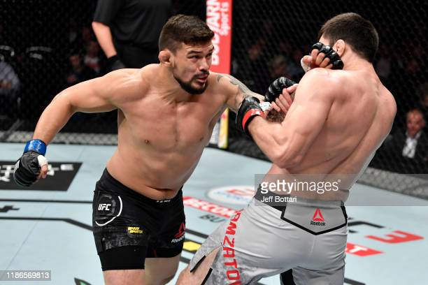 Klidson Abreu of Brazil punches Shamil Gamzatov of Russia in their light heavyweight bout during the UFC Fight Night event at CSKA Arena on November...