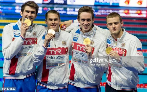 Kliment Kolesnikov Aleksandr Popkov Kirill Prigoda Vladimir Morozov of Russia win Gold in World Record Time during the Men's 4x50m Medley Relay Final...