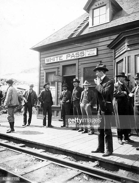 Klondike Goldrush gentleman and prospectors standing at the White Pass and Yukon Railroad Station in Alaska The station was a main point for...