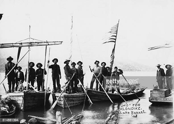 Group of men posed on their boats on Lake Bennett Ho for Klondike Undated photograph