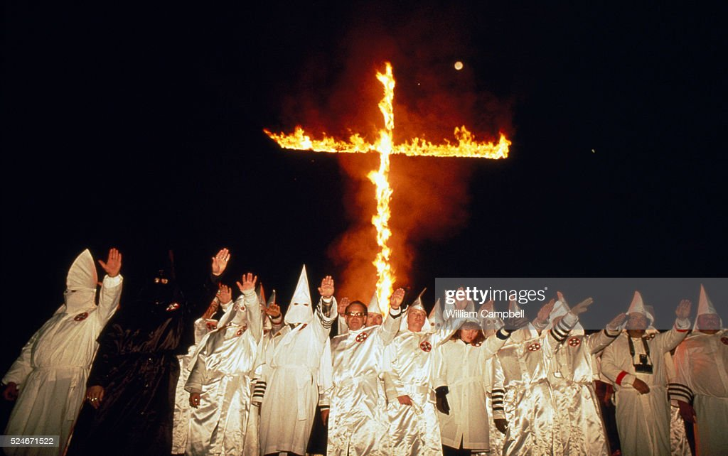 Klu Klux Klan Members Burning Cross : News Photo