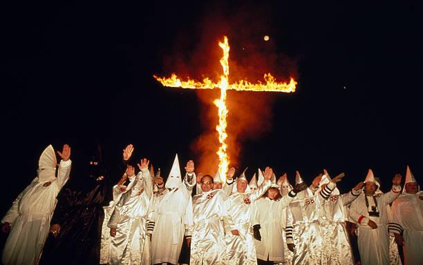 Klu Klux Klan Members Burning Cross