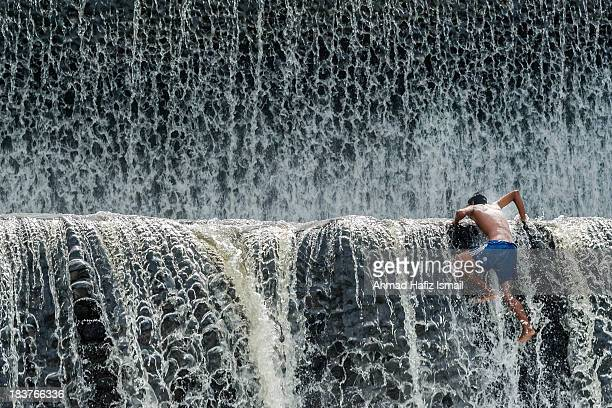 CONTENT] Klungkung Bali June 2013 A kid climbs up the Tukad Unda Dam located in Klungkung the smallest regency of Bali Tukad means river in the...