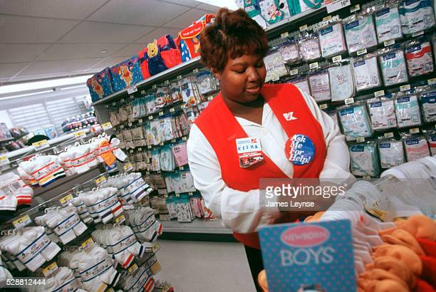 Kmart opens in Manhattan on 34th Street and Penn Station An employee works in the baby care section