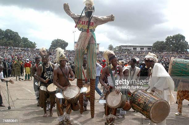 Guinean musicians performs prior to Libyan leader Moamer Kadhafi's speech in a football stadium in Knakri Guinea 25 June 2007 Kadhafi condemned 25...