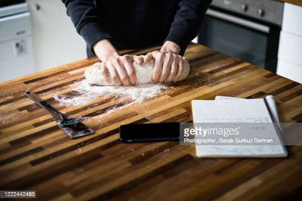kneading bread dough from wholemeal wheat / wholewheat flour - making stock pictures, royalty-free photos & images