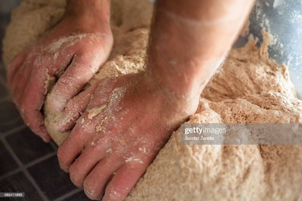 Kneading organic dough : Stock Photo
