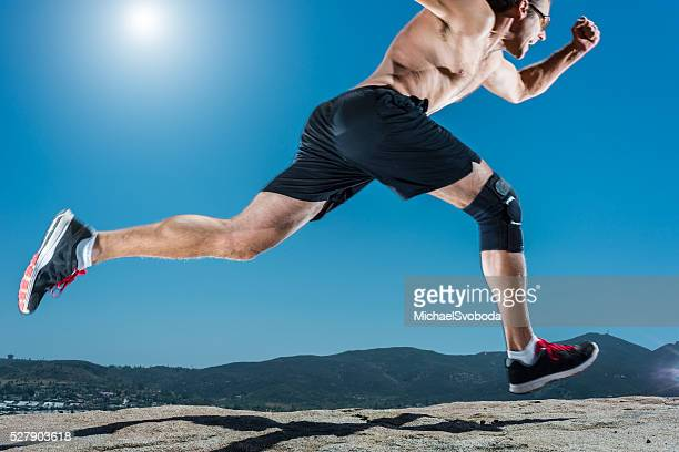 knee brace running up a granite boulder in the mountains - brace stock pictures, royalty-free photos & images