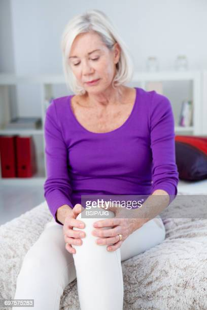 knee pain in an elderly person - knee stock photos and pictures
