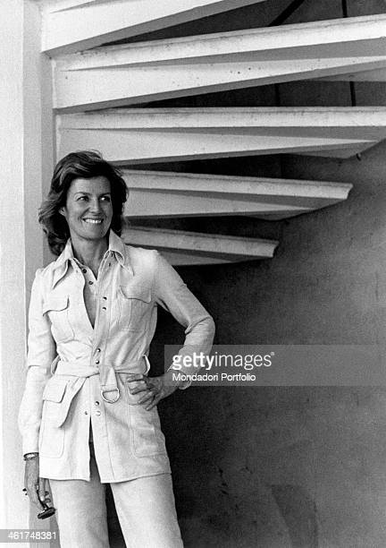 Kneefigure of the Italian actress and scriptwriter Marina Cicogna posing under a spiral staircase representative of the Sixties jet set she produced...