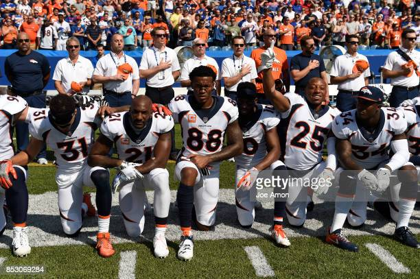 Kneeling during the national anthem before the Denver Broncos play the Buffalo Bills in week 3 at New Era Stadium Orchard Park NY