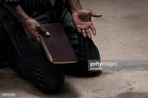 kneeling with bible
