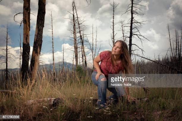 Kneeling Woman in a Burnt Forest