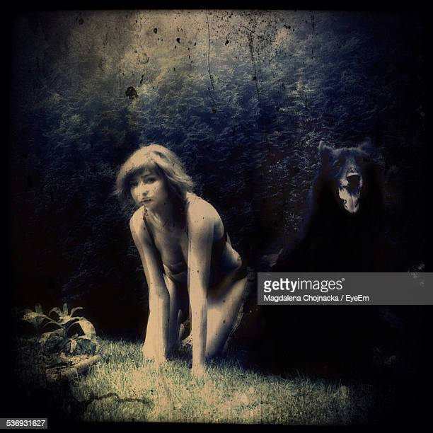 Kneeling Young Woman And Black Dog On Grass