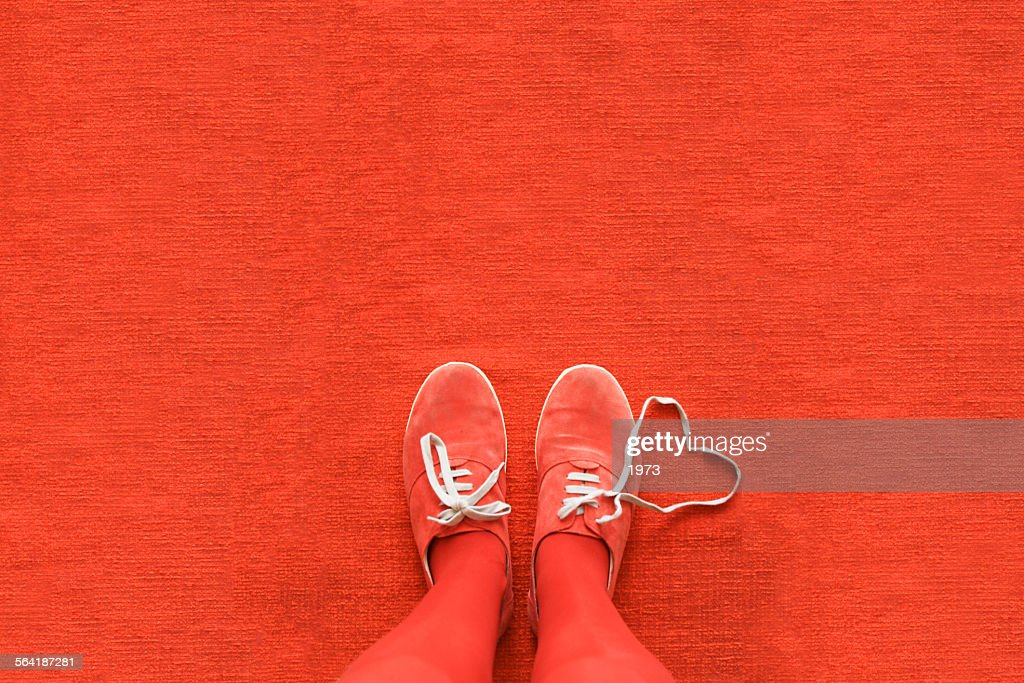 Knees down view of a woman's legs with a heart made out her shoelaces : Stock Photo