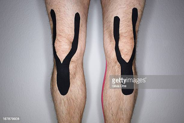 Knees with kinesiology tape
