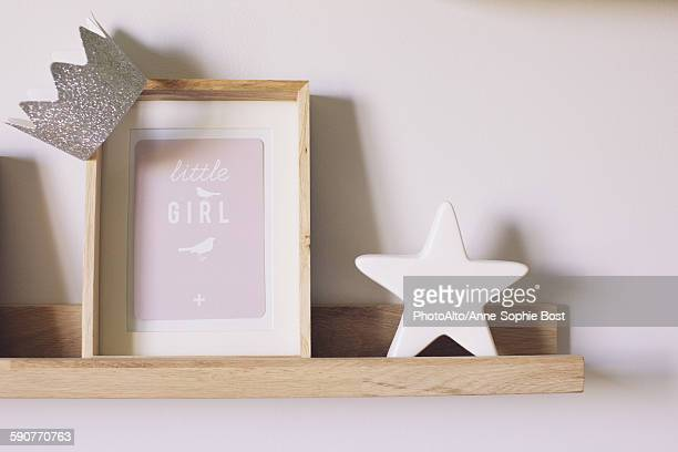 Knickknacks on shelf in little girls room