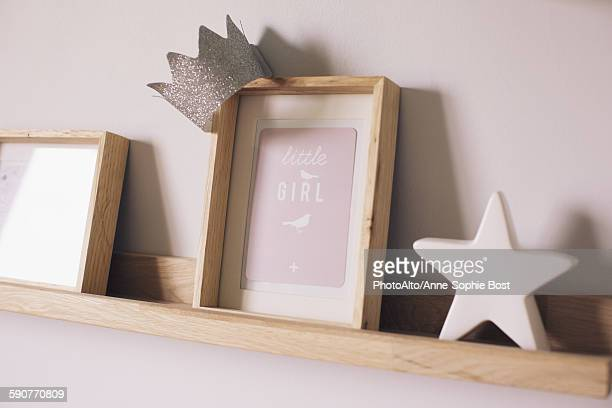 Knickknacks on shelf in little girls room