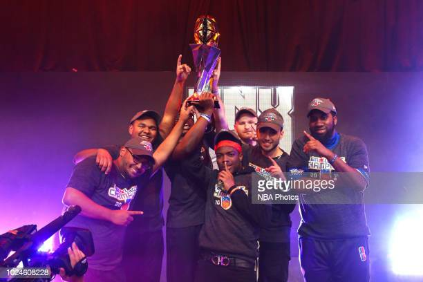 Knicks Gaming pose for a group photograph with the NBA 2K Championship trophy after Game Two of the 2018 NBA 2K League Finals on August 25 2018 at...