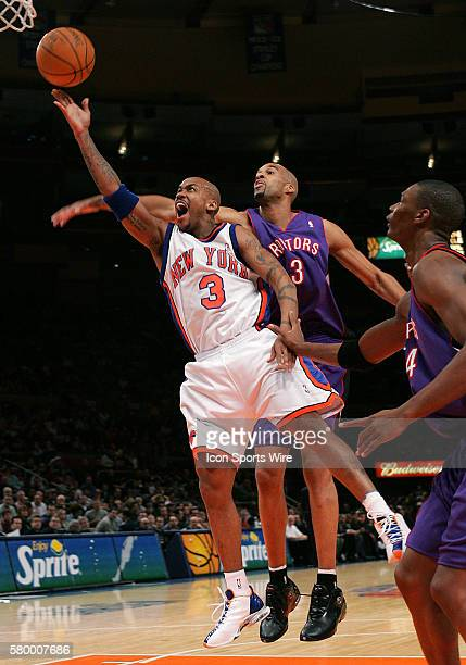 Knicks guard Stephon Marbury shoots in front of Toronto's Loren Woods in the first half at Madison Square Garden in New York Nov 27 2004
