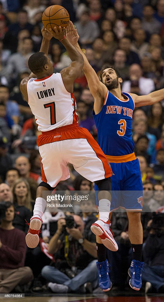 TORONTO - DECEMBER 21 - Knicks Jose Calderon tries to stop the shot of Raptors Kyle Lowry. Toronto Raptors vs New York Knicks during 1st half action at the Air Canada Centre of the NBA season on December 21, 2014.
