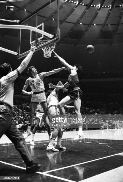 Knicks' Phil Jackson is caught red-handed fouling the Buffalo Braves John Hummer in the act of shooting and the referee is right in there to award...