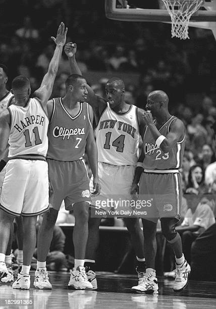 Knicks vs. Clippers - Knicks Derek Harper and Anthony Mason high five over Clippers Lamond Murray, Gary Grant of Clippers looks on.