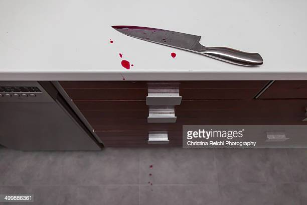 Knife and blood on kitchen counter