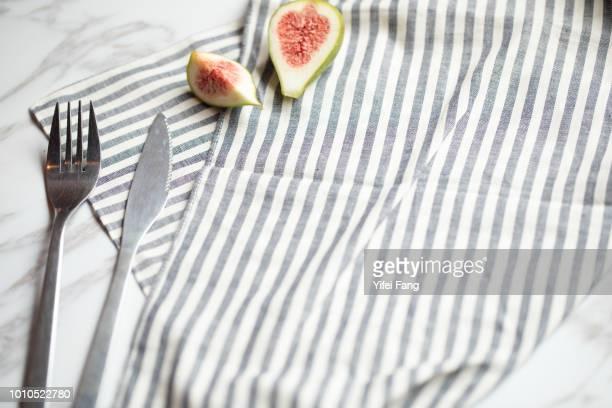 knife and fork on table with striped napkin - テーブルクロス ストックフォトと画像