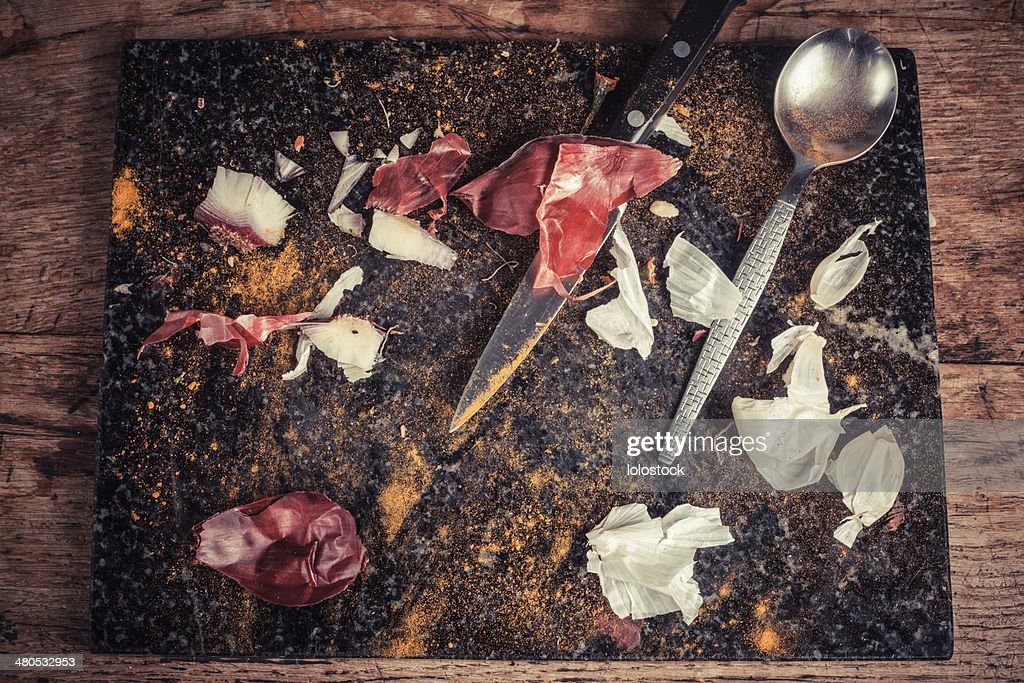 Knife and spoon on chopping board : Stock Photo