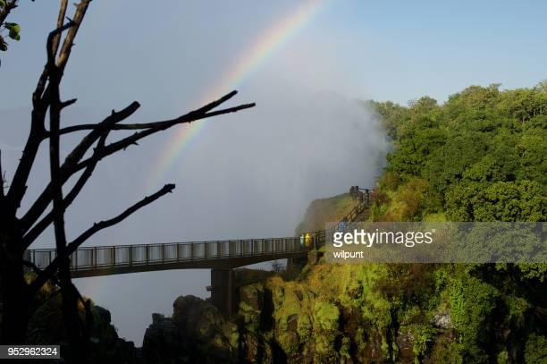 knife edge footbridge rainbow - zambia stock pictures, royalty-free photos & images