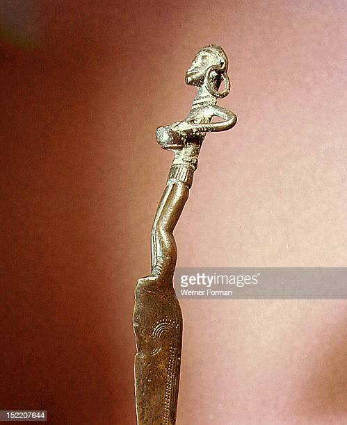 Knife handle in the form of a woman with a bowl Thought to represent the water goddess Denmark Pre Viking Bronze Age Holsten