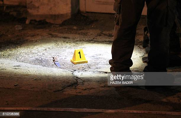 A knife is seen as Israeli security forces work at the site of a stabbing attack near the shared religious site known to Jews as the Cave of the...