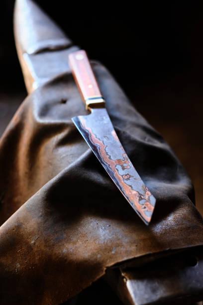 Knife on apron at workshop